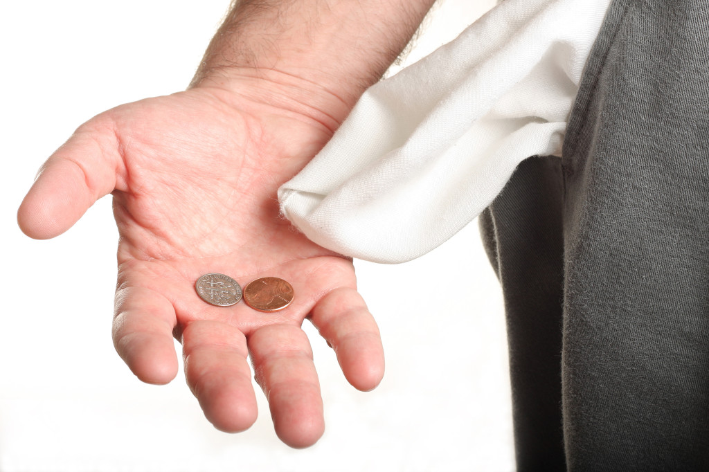bigstock-Man-With-Coins-In-Palm-And-Emp-2860079-1024x682.jpg