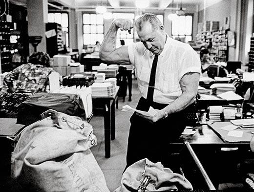 Charles-Atlas-1964-working-in-office-11.jpg